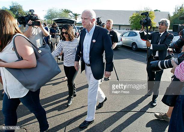 Sen John McCain exits the Mountain View Christian Church polling place after casting his vote on November 8 2016 in Phoenix Arizona Throughout the...