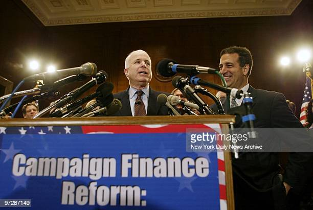 Sen John McCain gives a victory speech as Sen Russ Feingold looks on smilingly after the campaign finance reform bill they cosponsored passed in the...