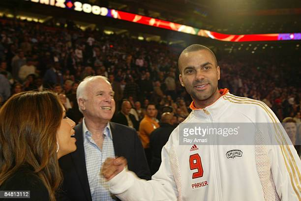 Sen John McCain greets Tony Parker of the Eastern Conference and his wife actress Eva Longoria during the 2009 NBA AllStar Game as part of 2009 NBA...