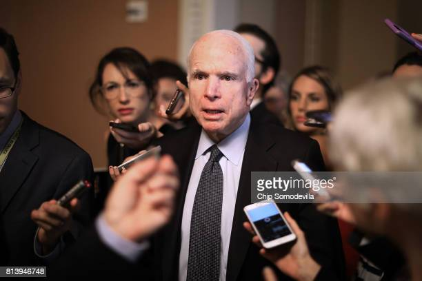 Sen John McCain leaves a meeting where a new version of a GOP healthcare bill was unveiled to Republican senators at the US Capitol July 13 2017 in...