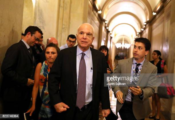 Sen John McCain leaves the the Senate chamber at the US Capitol after voting on the GOP 'Skinny Repeal' health care bill on July 28 2017 in...