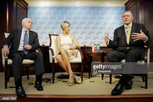 Sen John McCain left participates in a discussion on the unfolding violence in Iraq with retired Army Gen Jack Keane right and Danielle Pletka of the...