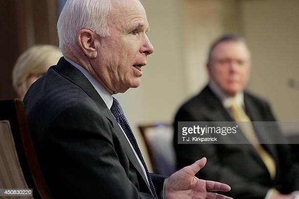 S Sen John McCain left participates in a discussion on the unfolding violence in Iraq with retired Army Gen Jack Keane and Danielle Pletka of the...