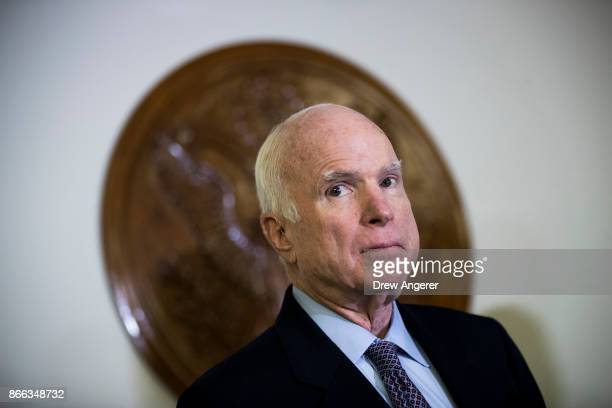 Sen John McCain looks on during a brief press conference before an Armed Services conference committee meeting on the National Defense Authorization...