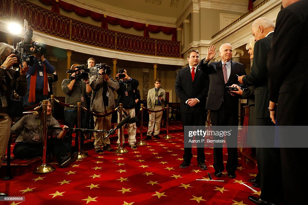U.S. Sen. John McCain (R-AZ) participates in a reenacted swearing-in with U.S. Vice President Joe Biden in the Old Senate Chamber at the U.S. Capitol January 3, 2017 in Washington, DC. Earlier in the day Biden swore in the newly elected and returning members on the Senate floor.