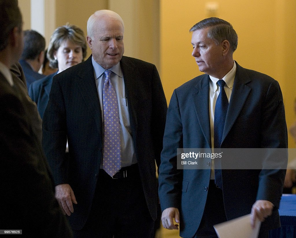 Sen. John McCain, R-Ariz., and Sen. Lindsay Graham, R-S.C., speak in the hallway following the Republican policy luncheon in the Capitol on Wednesday, Jan. 17, 2007.