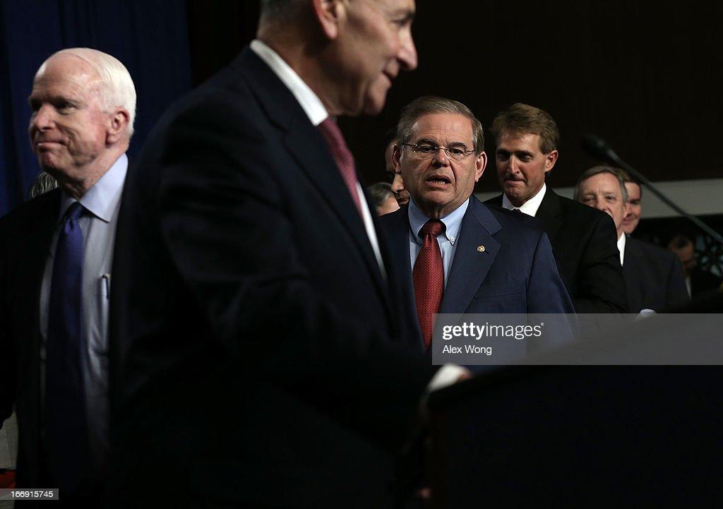 U.S. Sen. John McCain (R-AZ), Sen. Charles Schumer (D-NY), Sen. Robert Menendez (D-NJ), Sen. Jeff Flake (R-AZ), Sen. Richard Durbin (D-IL), and Sen. Michael Bennet (D-CO) arrive at a news conference on immigration reform April 18, 2013 on Capitol Hill in Washington, DC. The senators discussed on the 'Border Security, Economic Opportunity, and Immigration Modernization Act' that have been released on Wednesday.