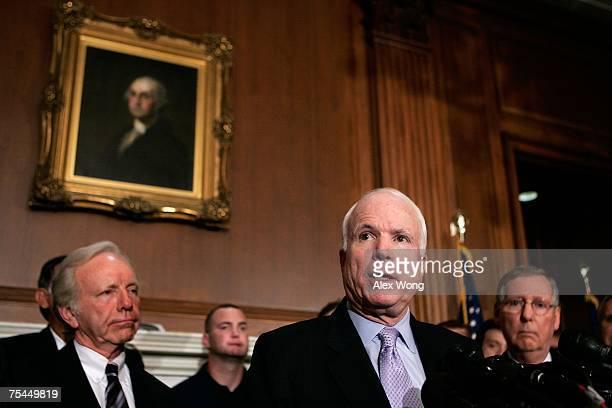 S Sen John McCain speaks as Sen Joseph Lieberman and Senate Minority Leader Sen Mitch McConnell listen during a news conference July 17 2007 on...