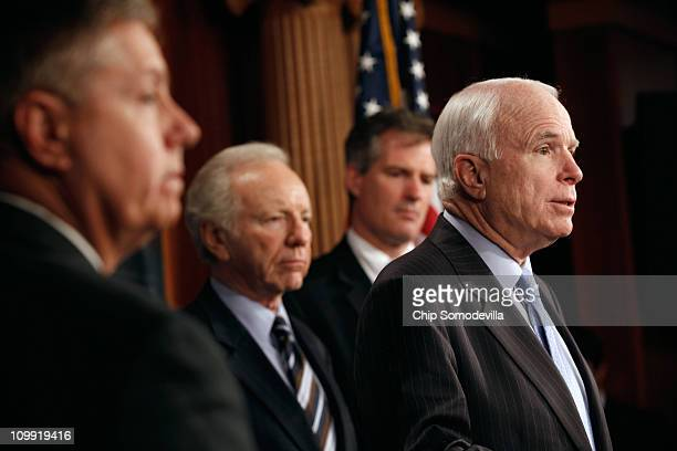 Sen John McCain speaks during a news conference with fellow senators Sen Lindsey Graham Sen Joe Lieberman and Sen Scott Brown at the US Capitol March...