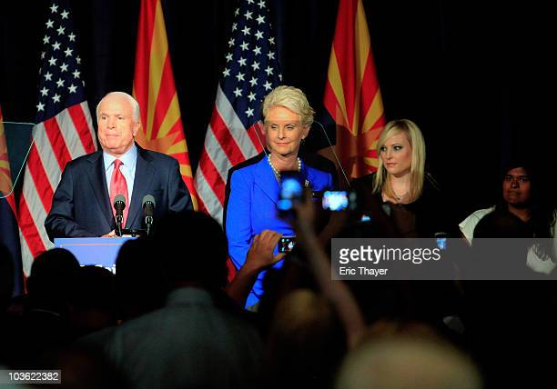 S Sen John McCain speaks to a group of supporters alongside his wife Cindy and daughters Meghan McCain and Bridget McCain at his victory party after...