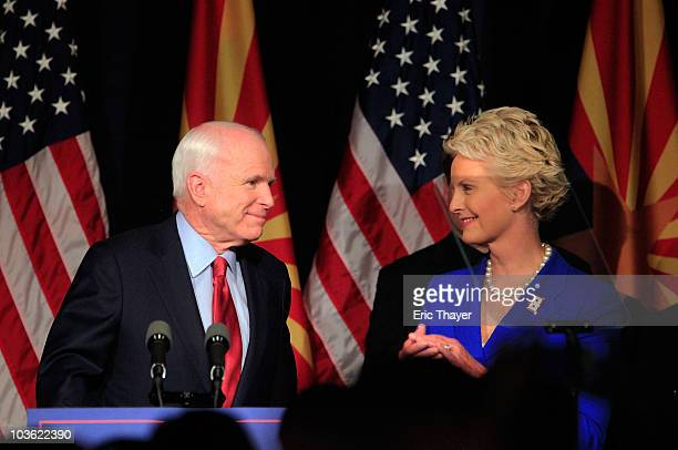 S Sen John McCain speaks to a group of supporters alongside his wife Cindy at his victory party after winning Arizona's primary election August 24...