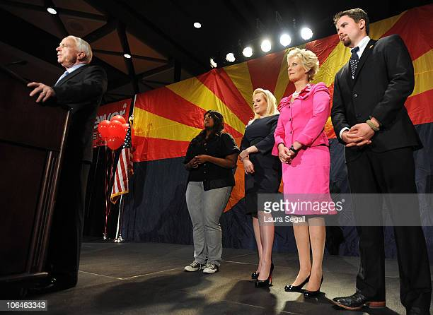 Sen John McCain speaks to the crowd with his wife Cindy McCain and daughters Meghan McCain and Bridget McCain during an Arizona Republican Party...