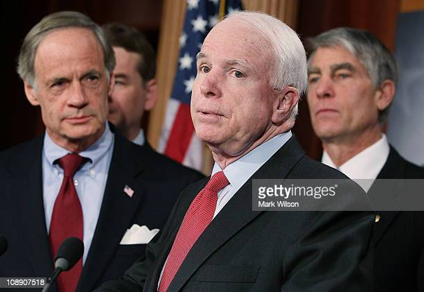 Sen. John McCain , speaks while flanked by U.S. Sen. Tom Carper , and U.S. Sen. Mark Udall , during a news conference about a proposed line-item...