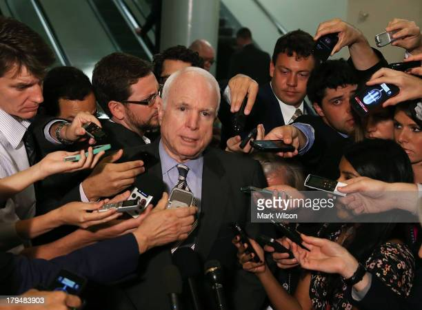 S Sen John McCain talks to reporters after leaving a closed door meeting about Syria at the US Capitol on September 4 2013 in Washington DC Later...