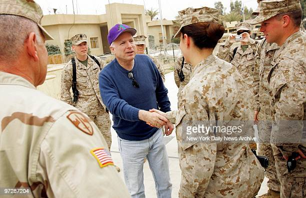 Sen John McCain talks with Marines at Camp Fallujah outside of Fallujah Iraq during a stop at the Camp with four other senators including Hillary...