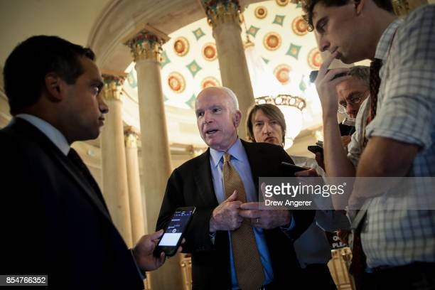 Sen John McCain talks with reporters on his way to a meeting with Republican Senators September 27 2017 in Washington DC On Wednesday Republican...