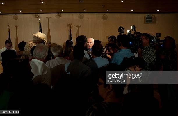 Sen John McCain talks with veterans their families and the media during a forum with Arizona Veterans over mismanagement at the Phoenix VA May 9 2014...