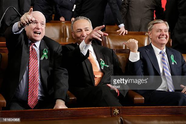 US Sen John McCain US Sen Charles Schumer DNY and US Sen Lindsey Graham sit on Capitol Hill on February 12 2013 in Washington DC Facing a divided...
