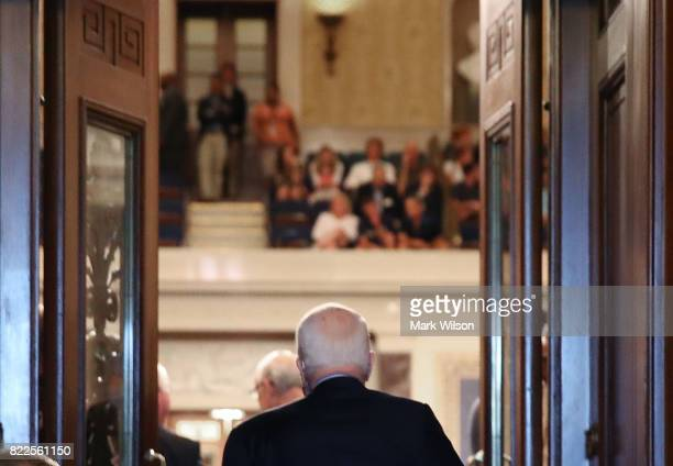 Sen John McCain walks into the US Senate chamber on July 25 2017 in Washington DC McCain was recently diagnosed with brain cancer but returned on the...