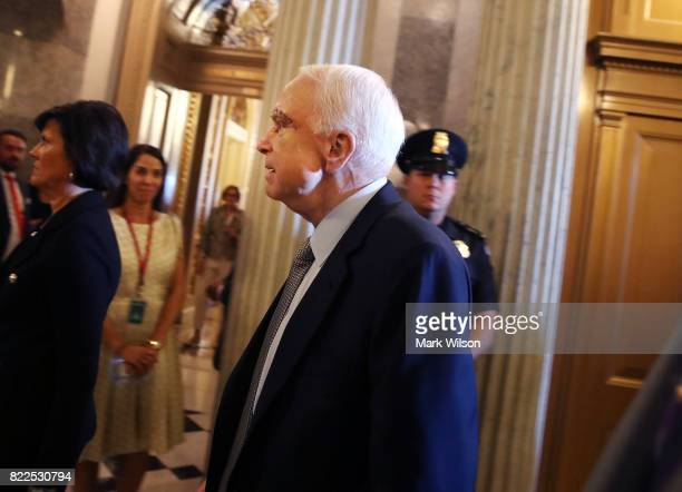 Sen John McCain walks to the US Senate chamber July 25 2017 in Washington DC McCain was recently diagnosed with brain cancer but returned on the day...
