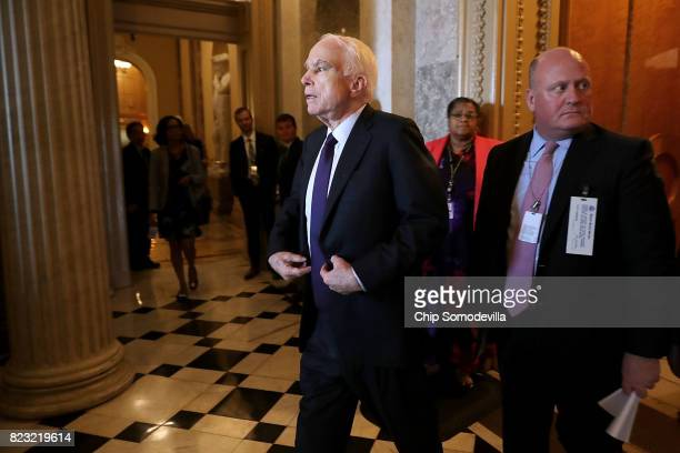 Sen John McCain who was recently diagnosed with brain cancer leaves the Senate Chamber following votes in the US Capitol July 26 2017 in Washington...