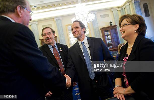 Sen John Rockefeller DWV left chairman of the Senate Commerce Science and Transportation Committee greets Mike Rowe center producer and host of...