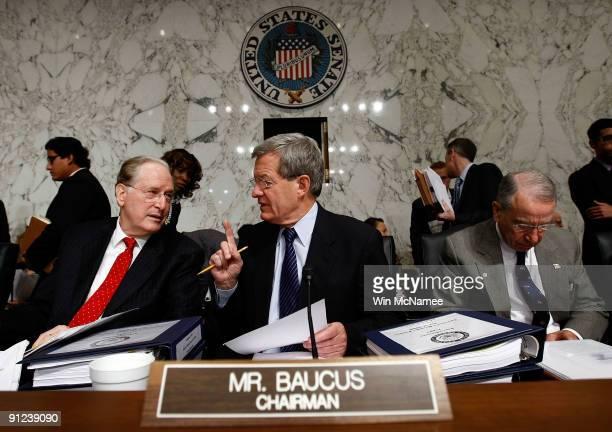 "Sen. John Rockefeller talks with Committee Chairman Sen. Max Baucus before the start of the full Senate Finance Committee markup of ""The America's..."