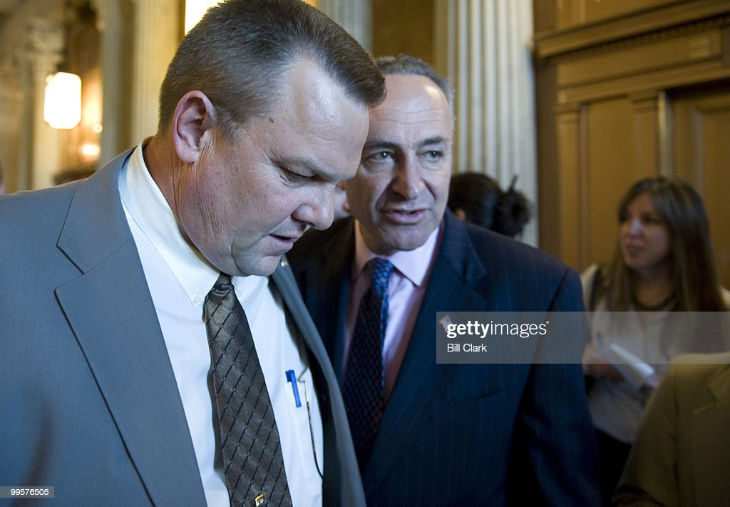 Sen. John Tester, D-Mont., and Sen. Charles Schumer, D-N.Y., talk as they make their way into the weekly Senate Domocratic Policy Luncheon on Wednesday, May 7, 2008., in the U.S. Capitol building.