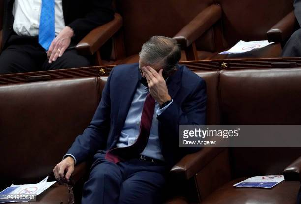 Sen. John Thune hangs his head in the House Chamber during a reconvening of a joint session of Congress on January 06, 2021 in Washington, DC....
