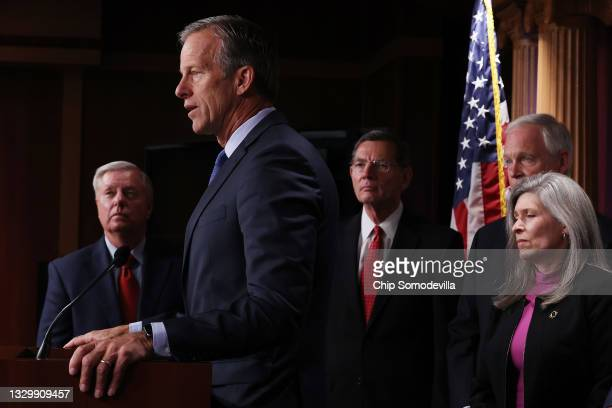 Sen. John Thune speaks to reporters during a news conference with Sen. Lindsey Graham , Sen. John Barrasso , Sen. Ron Johnson and Sen. Joni Ernst at...