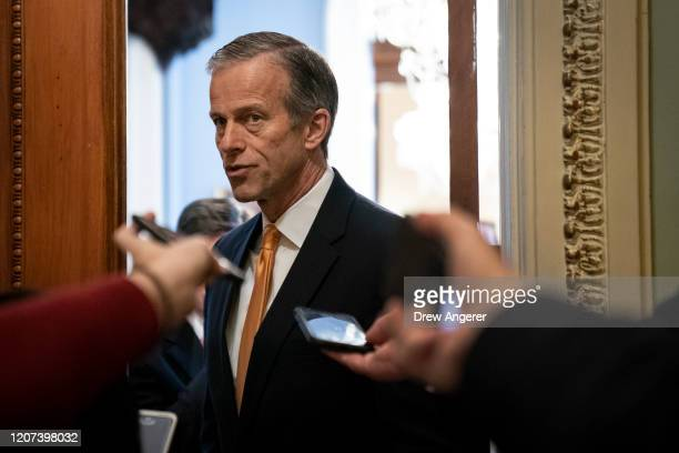 Sen. John Thune talks to reporters outside his office at the U.S. Capitol March 16, 2020 in Washington, DC. After taking the weekend off, the Senate...