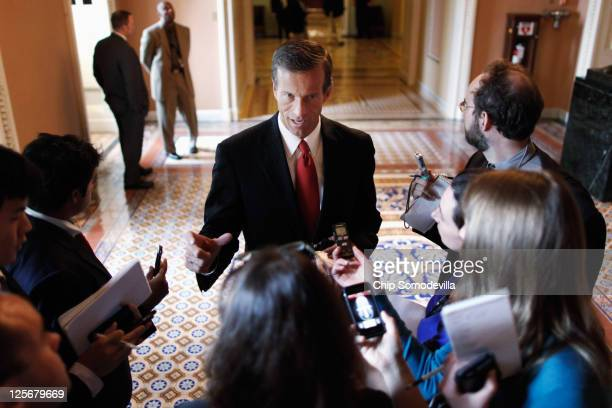 Sen. John Thune talks with reporters as he heads to the weekly Senate Republican policy luncheon at the U.S. Capitol September 20, 2011 in...