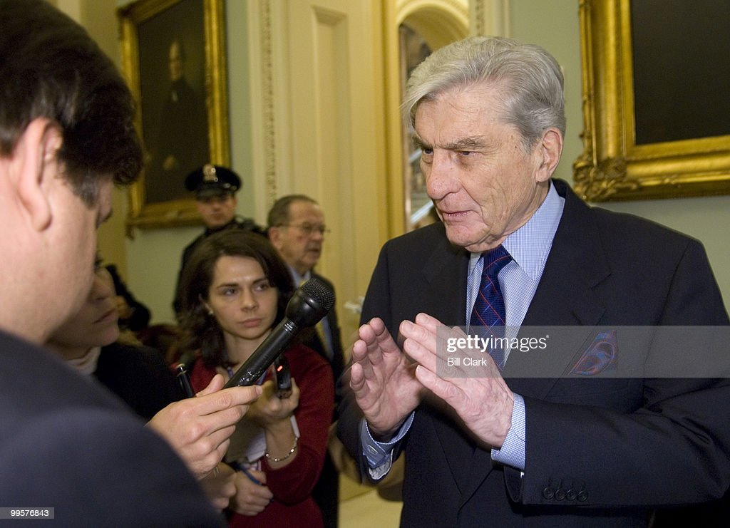 Sen. John Warner, R-Va., stops to speak with reporters about Iraq on his way into the Republican Policy Committee meeting on Capitol Hill on Tuesday, Jan. 9, 2007.