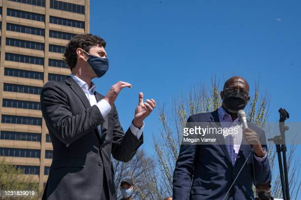 Sen. Jon Ossoff and Sen. Raphael Warnock speak to a group of demonstrators showing their support for Asian-American and Pacific Islander communities...