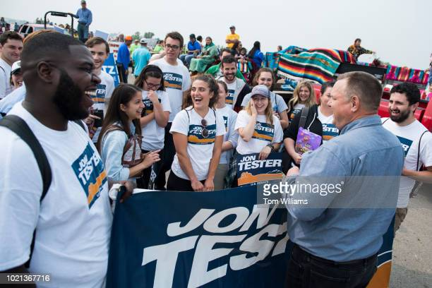 Sen Jon Tester DMont talks with campaign volunteers before a parade at Crow Fair in Crow Agency Mont on August 19 2018 Tester is being challenged by...