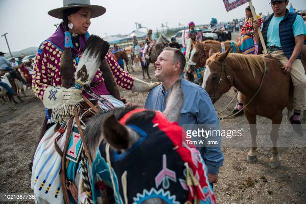 Sen Jon Tester DMont talks with constituents before a parade at Crow Fair in Crow Agency Mont on August 19 2018 Tester is being challenged by...