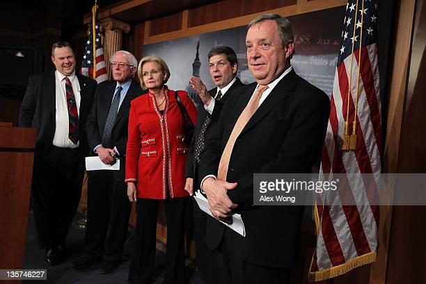 US Sen Jon Tester Sen Bernie Sanders Sen Claire McCaskill Sen Mark Begich and Senate Majority Whip Sen Richard Durbin participate in a news...