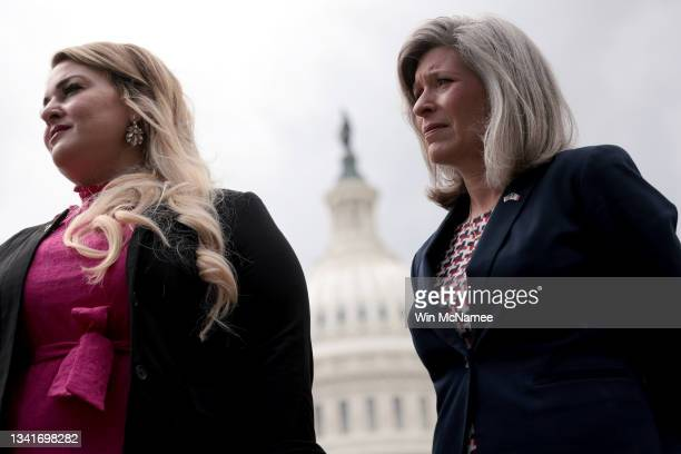 Sen. Joni Ernst and Gold Star spouse Jane Horton , attend a press conference outside the U.S. Capitol September 21, 2021 in Washington, DC. Ernst and...