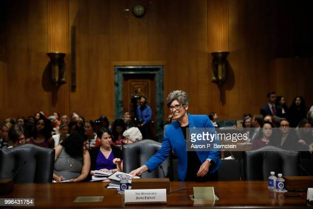 Sen Joni Ernst arrives for a Commerce Committee hearing on paid family leave July 11 2018 on Capitol Hill in Washington DC Legislators are hoping to...