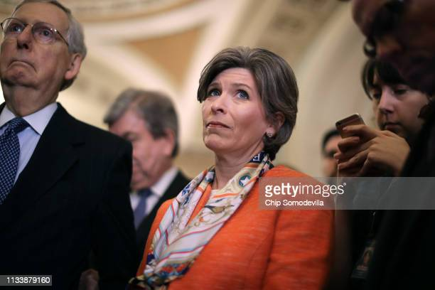 Sen Joni Ernst joins fellow Republicans including Senate Majority Leader Mitch McConnell for a news conference following their weekly policy luncheon...