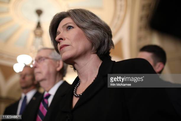 Sen Joni Ernst listens to questions from reporters following the weekly Republican policy luncheon at the US Capitol February 26 2019 in Washington...