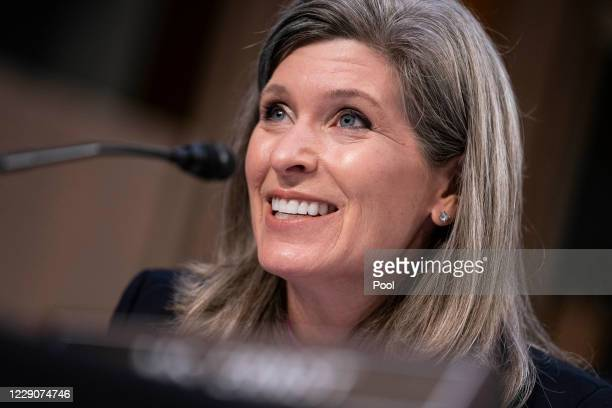Sen. Joni Ernst questions Supreme Court nominee Judge Amy Coney Barrett as she testifies before the Senate Judiciary Committee on the third day of...