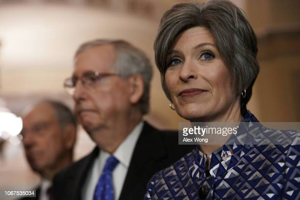 US Sen Joni Ernst Senate Majority Leader Sen Mitch McConnell and Sen Chuck Grassley listen during a media briefing after a leadership election...