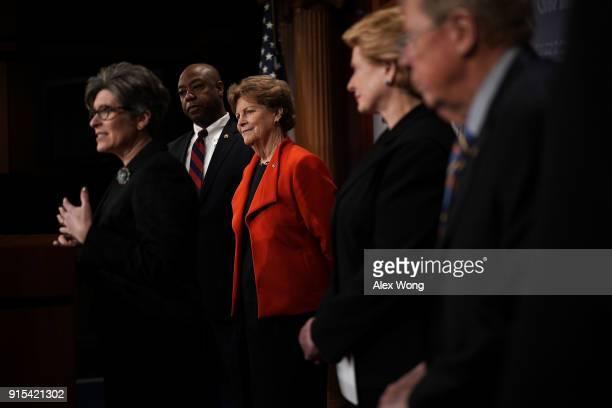 US Sen Joni Ernst speaks as Sen Tim Scott Sen Jeanne Shaheen Sen Debbie Stabenow and Sen Johnny Isakson listen during a news conference at the...
