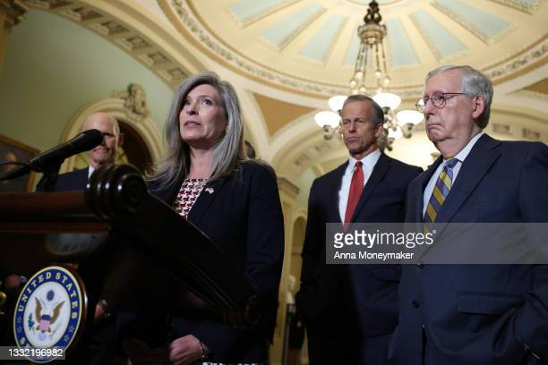 Sen. Joni Ernst speaks at a news conference, as Sen. John Thune and Senate Minority Leader Mitch McConnell look on following a policy luncheon at the...