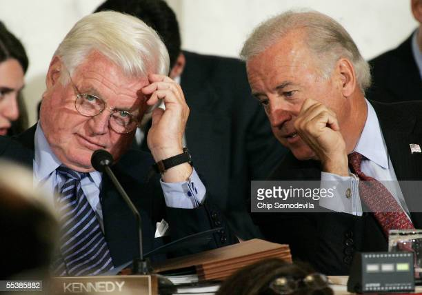 Sen. Joseph Biden confers with Sen. Ted Kennedy during opening remarks on the first day of confirmation hearings for Supreme Court Chief Justice...