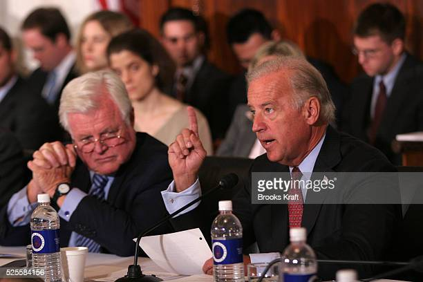 Sen. Joseph Biden , D-Del., right, addresses Supreme Court nominee John G. Roberts, not shown, during his confirmation hearing as Sen. Ted Kennedy,...