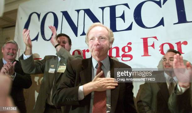 S Sen Joseph Lieberman DConn soon to be Al Gore's running mate for VicePresident celebrates in front of the AFLCIO convention at the Hilton Hotel in...