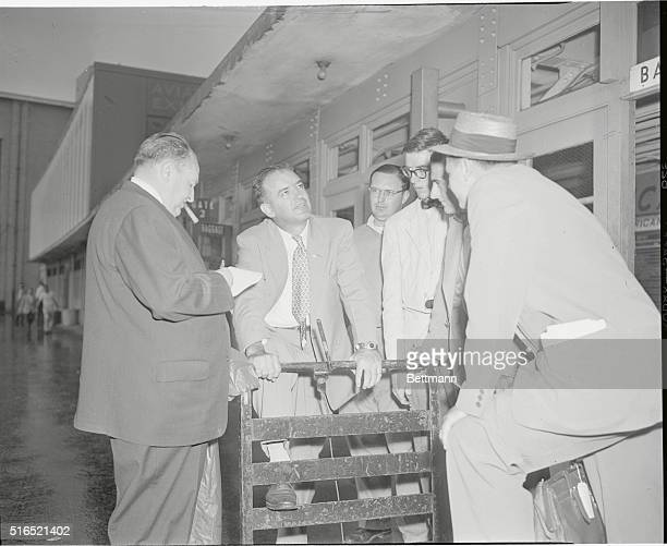 Sen. Joseph McCarthy talks to reporters upon arrival at LaGuardia Airport yesterday. The Wisconsin Senator said he would campaign for Gen. Eisenhower...