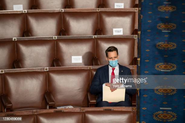 Sen. Josh Hawley, R-Mo., attends a joint session of Congress to certify the Electoral College votes of 2020 presidential election in the House...